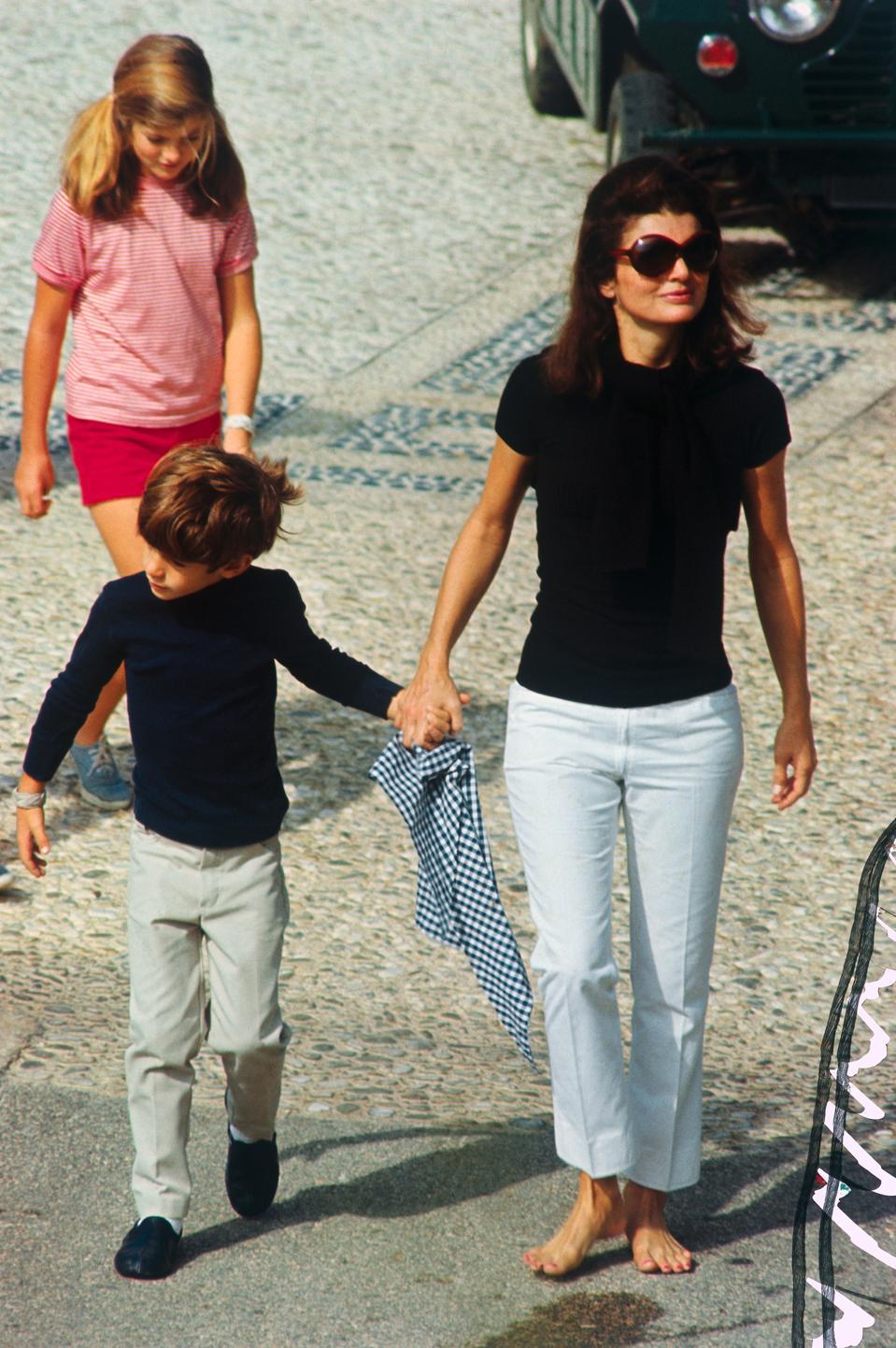 Jacqueline Kennedy walking with her children