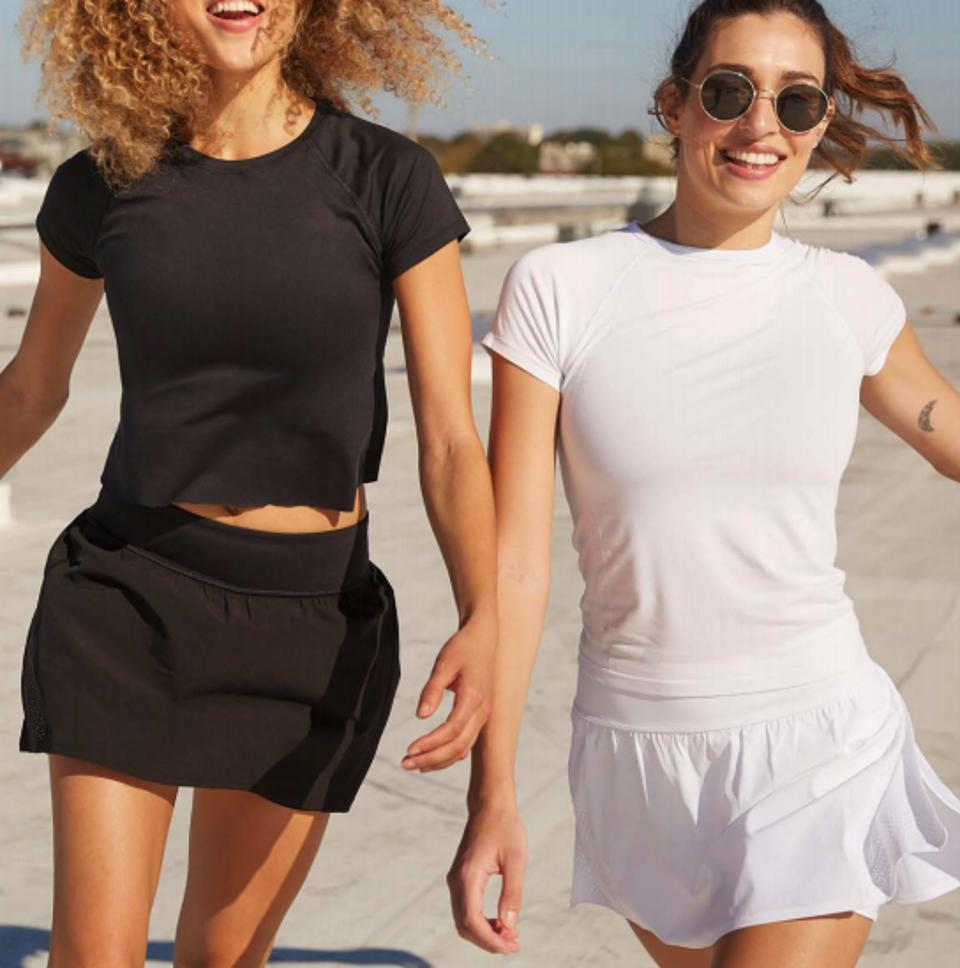 two models wearing t shirt and matching skorts in black and white respectively