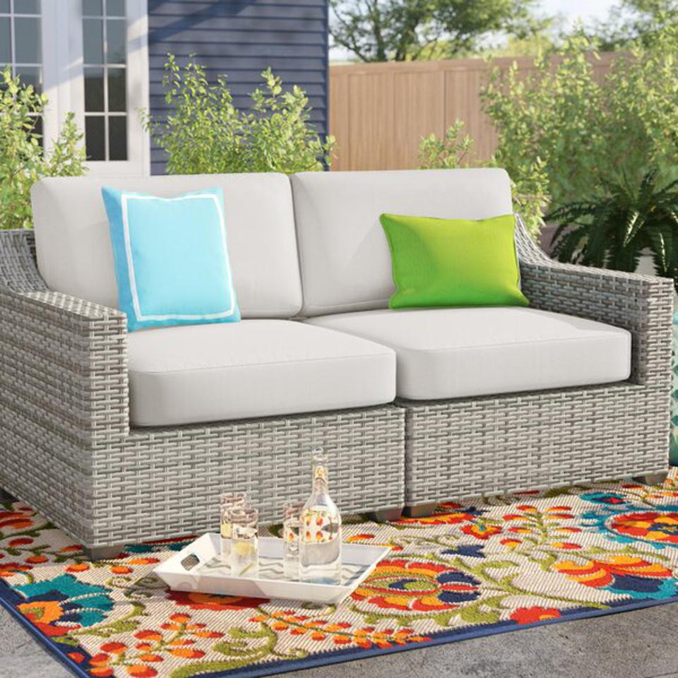 Outdoor furniture deals: Sol 72 Outdoor™ Falmouth 70″ Wide Outdoor Wicker Loveseat with Cushions & Reviews | Wayfair