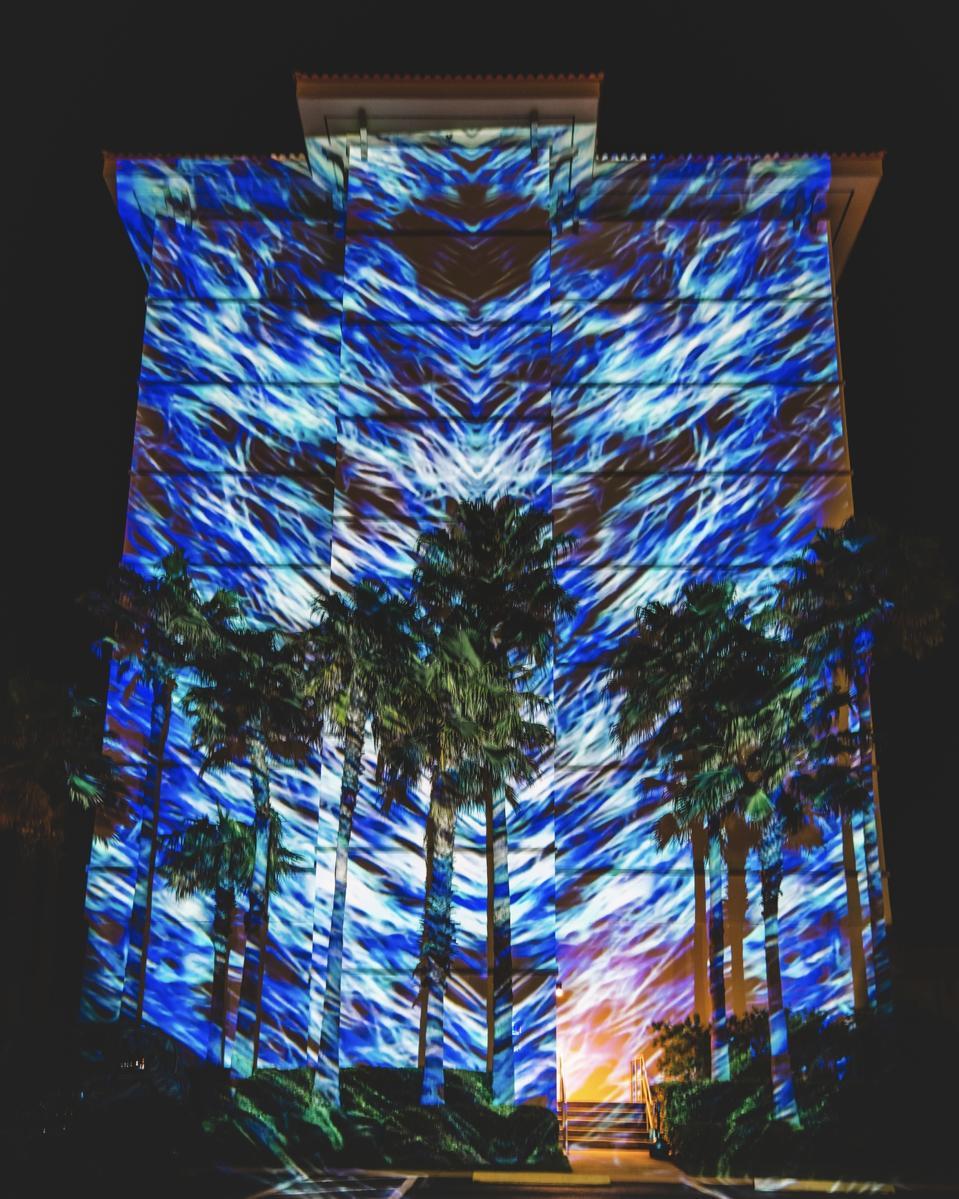 Can Buyukberber digital art projection, ″Primordial Force,″ at One Ocean Resort & Spa in Atlantic Beach, FL during ″enLIGHTen″ Art Festival.