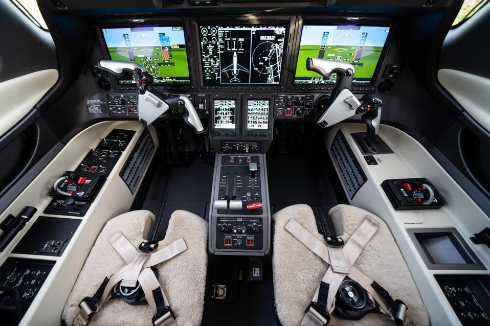 Advanced avionics in a Phenom 300E cockpit