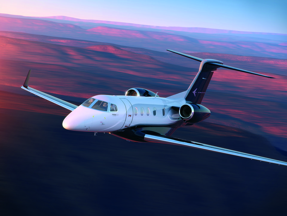 Private jet in flight at sunset