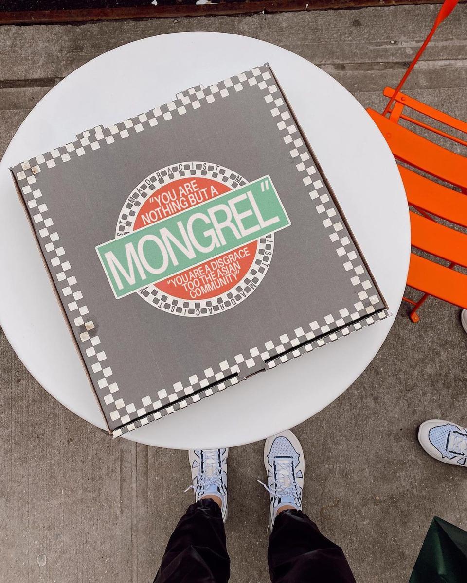 A pizza box with racist language photoshopped onto it