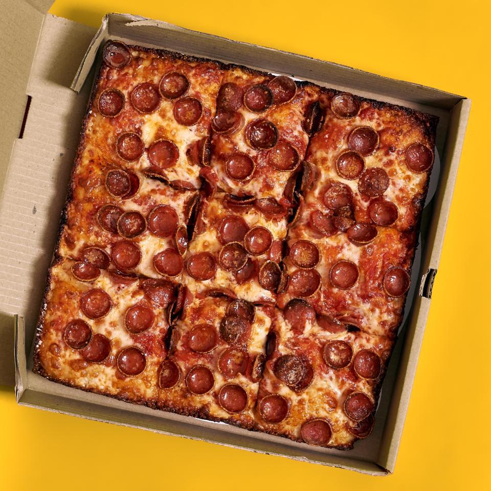 Sicilian pepperoni pizza in a pizza box