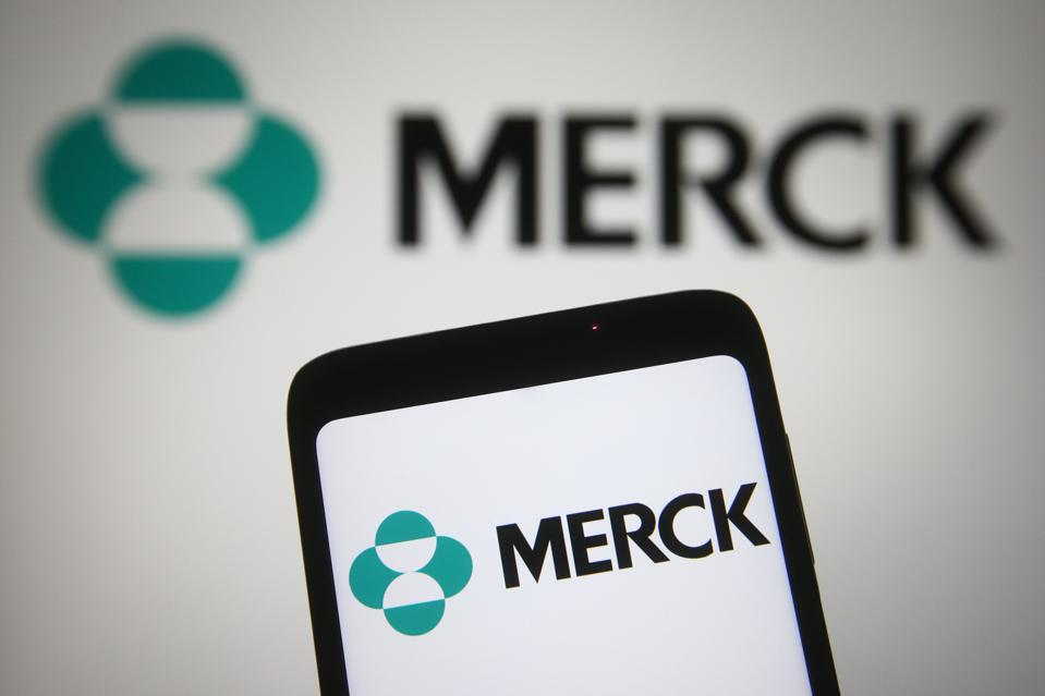 In this photo illustration, Merck & Co. logo of a...