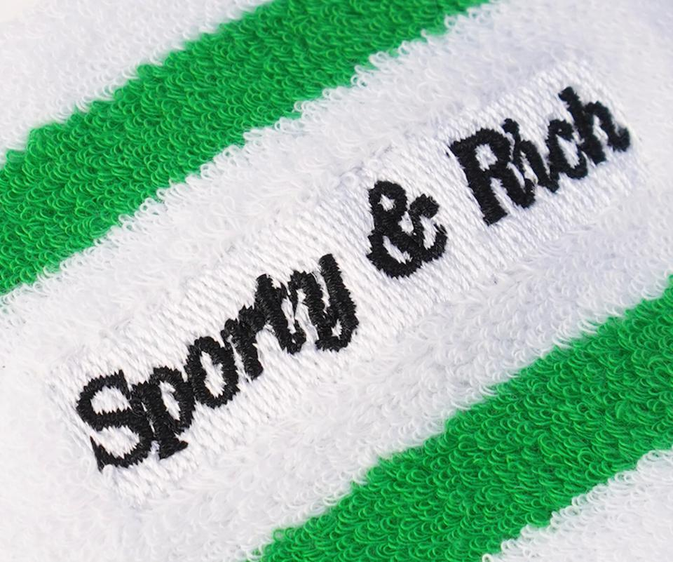 Sporty & Rich in black print on white terry cloth with green stripes