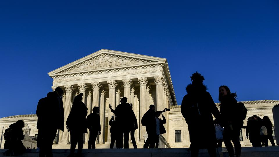 U.S. Supreme Court building with people in front of it