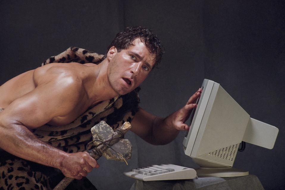Caveman baffled by computer