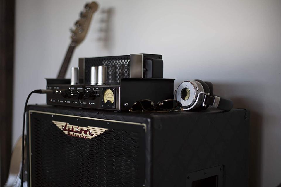 Meters OV-1-B-Connect headphones on a guitar amplifier