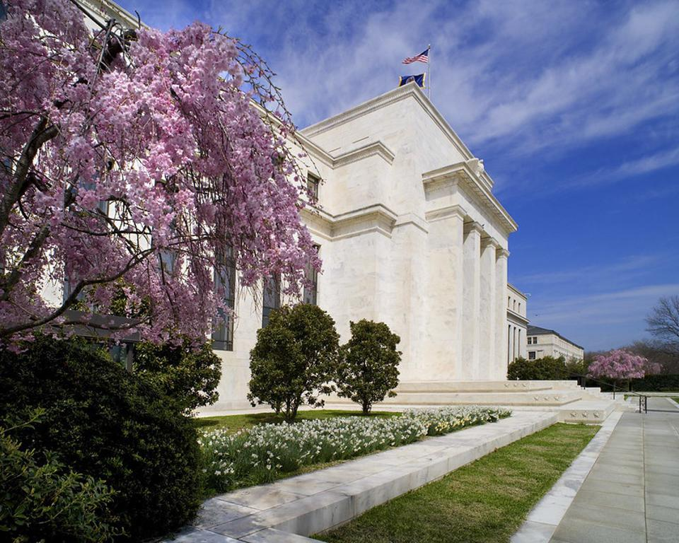 Federal Reserve officials plan to keep interest rates low until the economy firms.