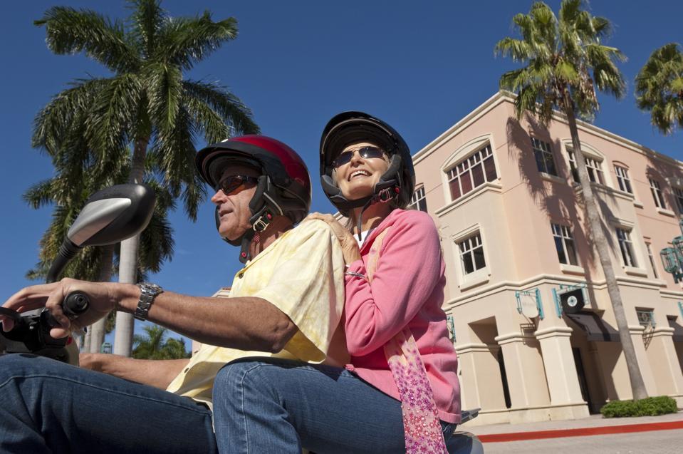 Senior caucasian couple on motor scooter..
