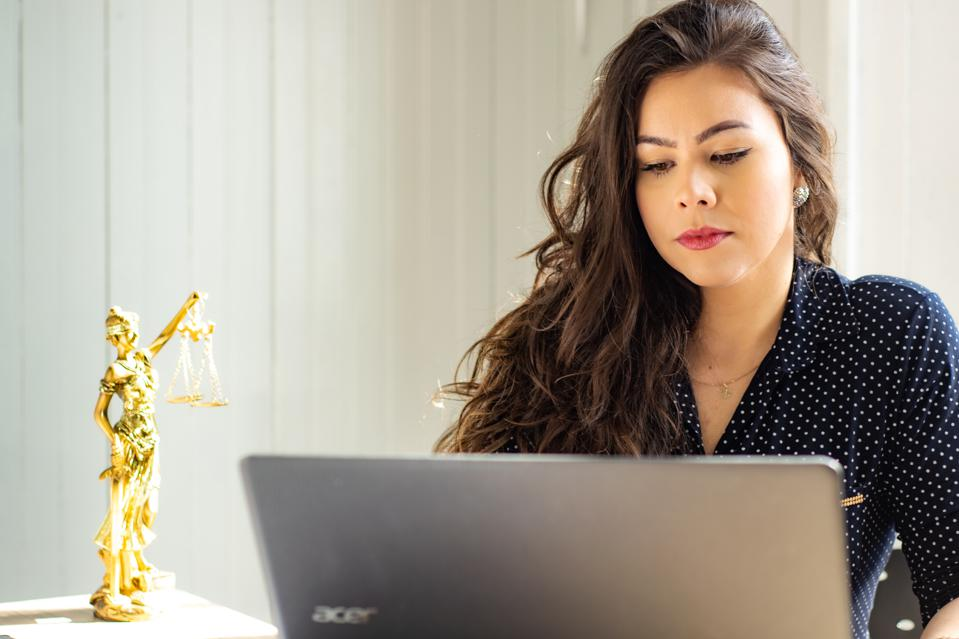 A woman attorney working in her office