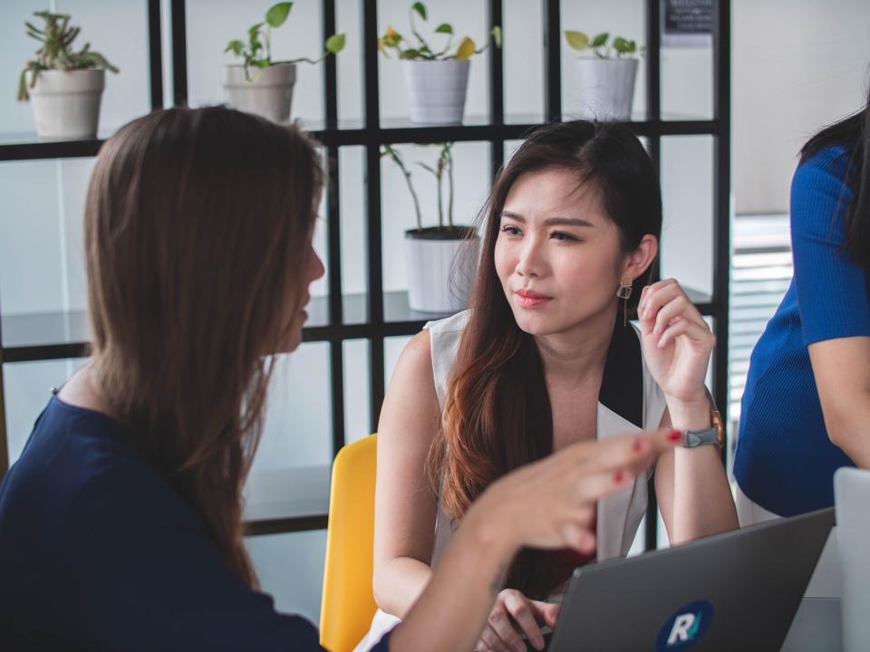 Women discussing issues in an office