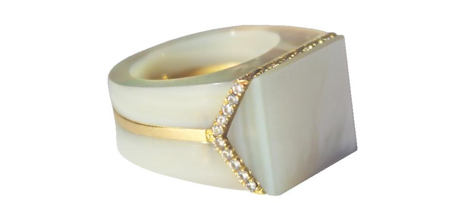 The V Signet ring by Melanie Georgacopulos, 18kt gold, white and lavender mother of pearl and white diamonds.