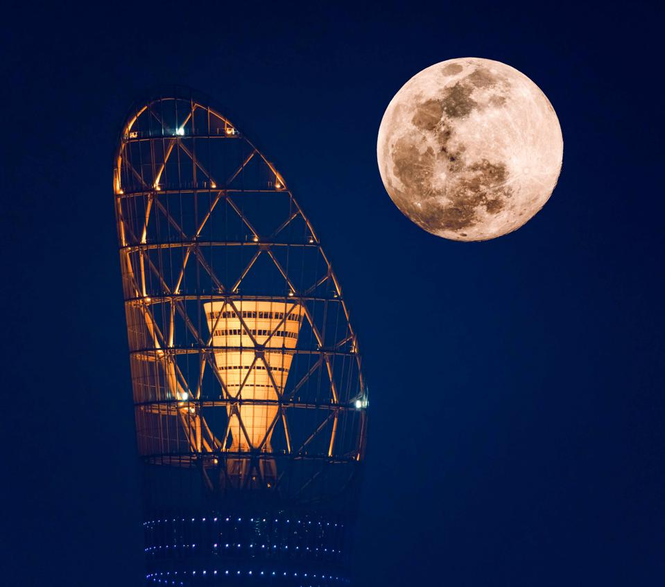 Qatar National Tourism Council (QNTC) has captured the incredible Pink Supermoon above the Torch Tower in Doha and in the Al Aamriya Desert. Partnering with local astro-photographer Vinay Swaroop Balla, the striking images show the moon rising above the country's iconic locations.