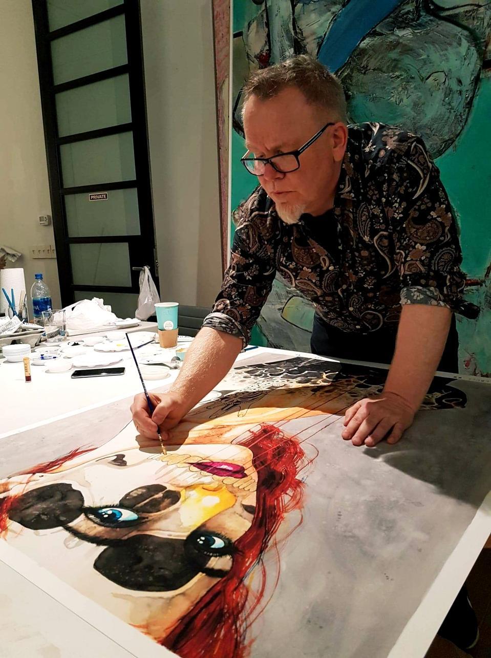 Artist Ole Aakjær works in his studio in Denmark.