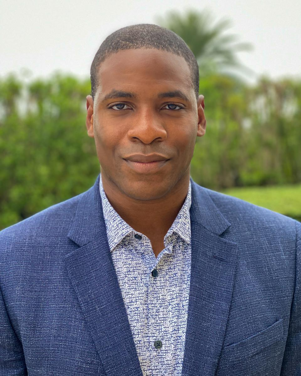 Head shot of former NFL player Wale Ogunleye, head of sports partnerships for UBS Sports and host of 'Long Game' series