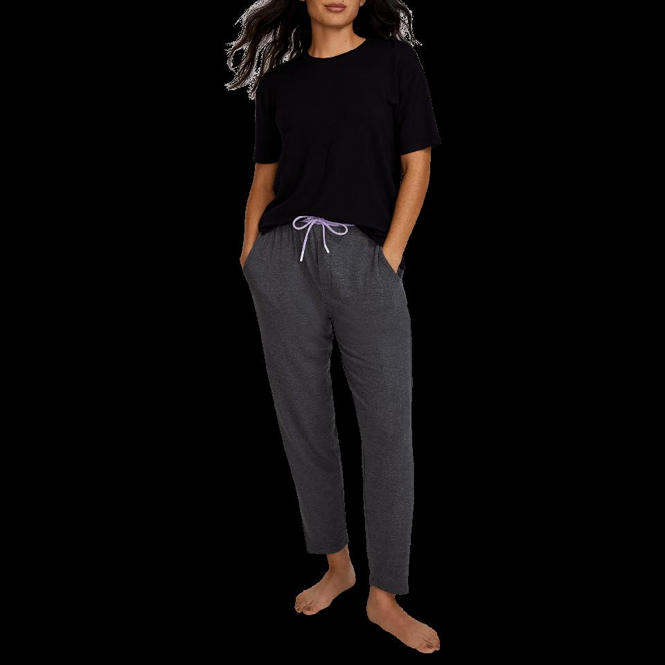 A woman wears a pair of grey Long Jambys.