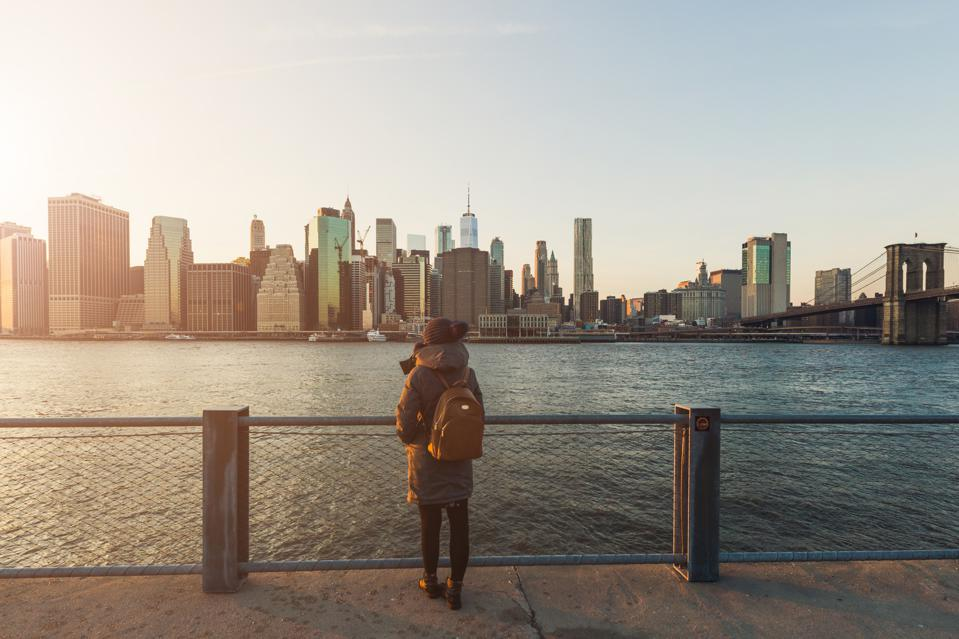 Woman Standing in Front of Manhattan, New York