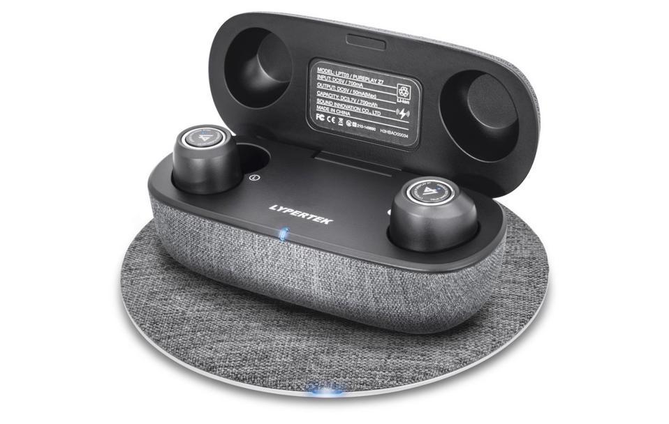 Lypertek PurePlay Z7 on a wireless charging mat.