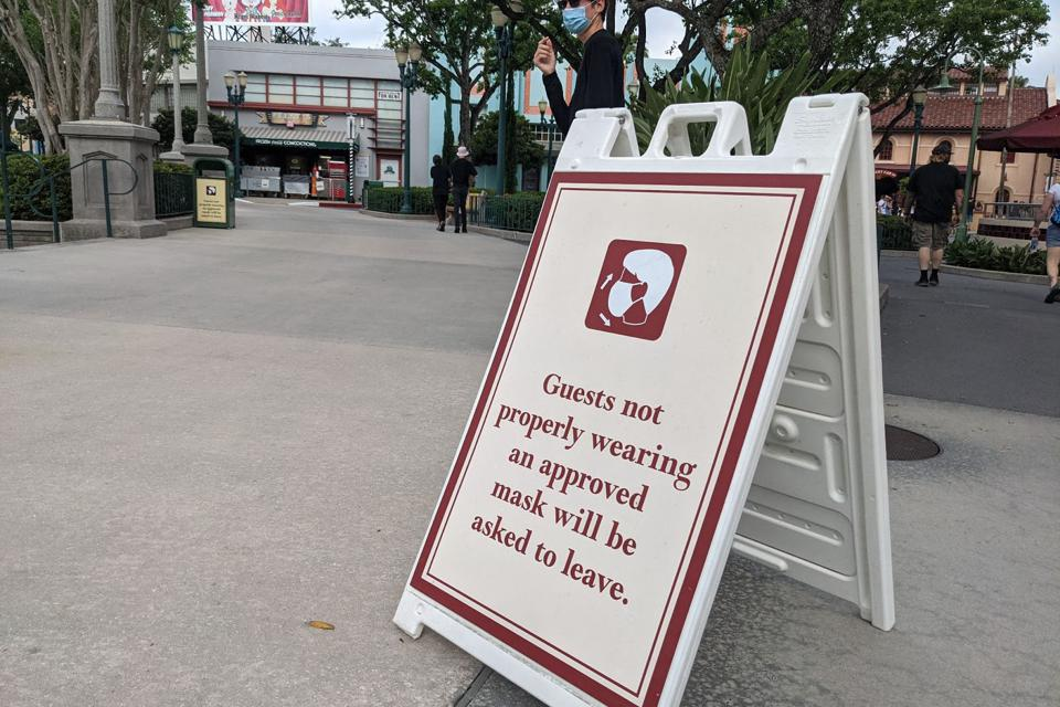 This is what it's like to travel to Florida now: A sign at Disney Studios warns visitors to keep their masks on or face expulsion.