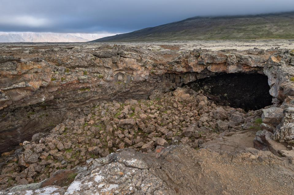 Entrance to the lava caves Surtshellir and Stefanshellir, lava field Hallmundarhraun, Iceland