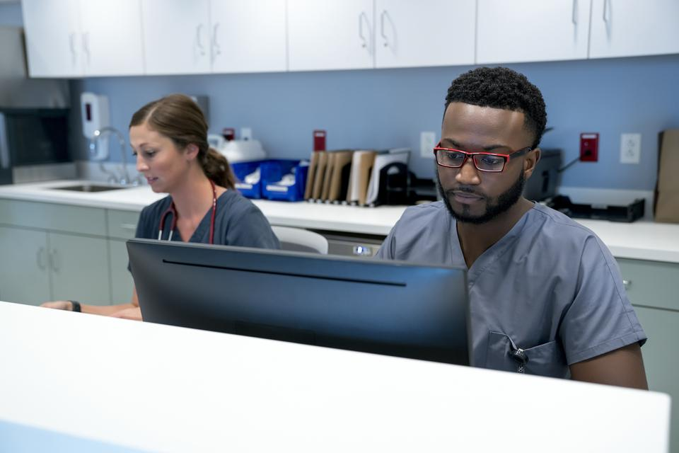 Doctors working at hospital reception