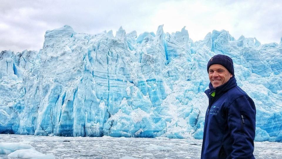 Captain Luke Hoskins before ice walls in Patagonia