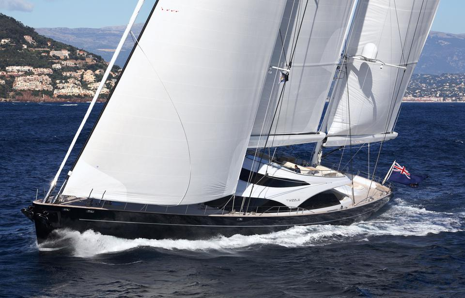 Twizzle superyacht with full sails at sea