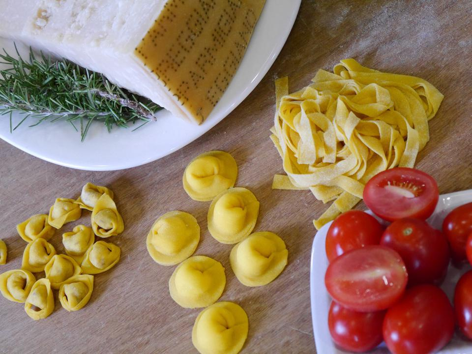 Some of the staples of the cuisine of Emilia Romagna including tortellino, tortelli and fettucini