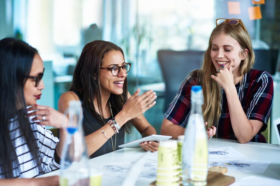 Women at business meeting.