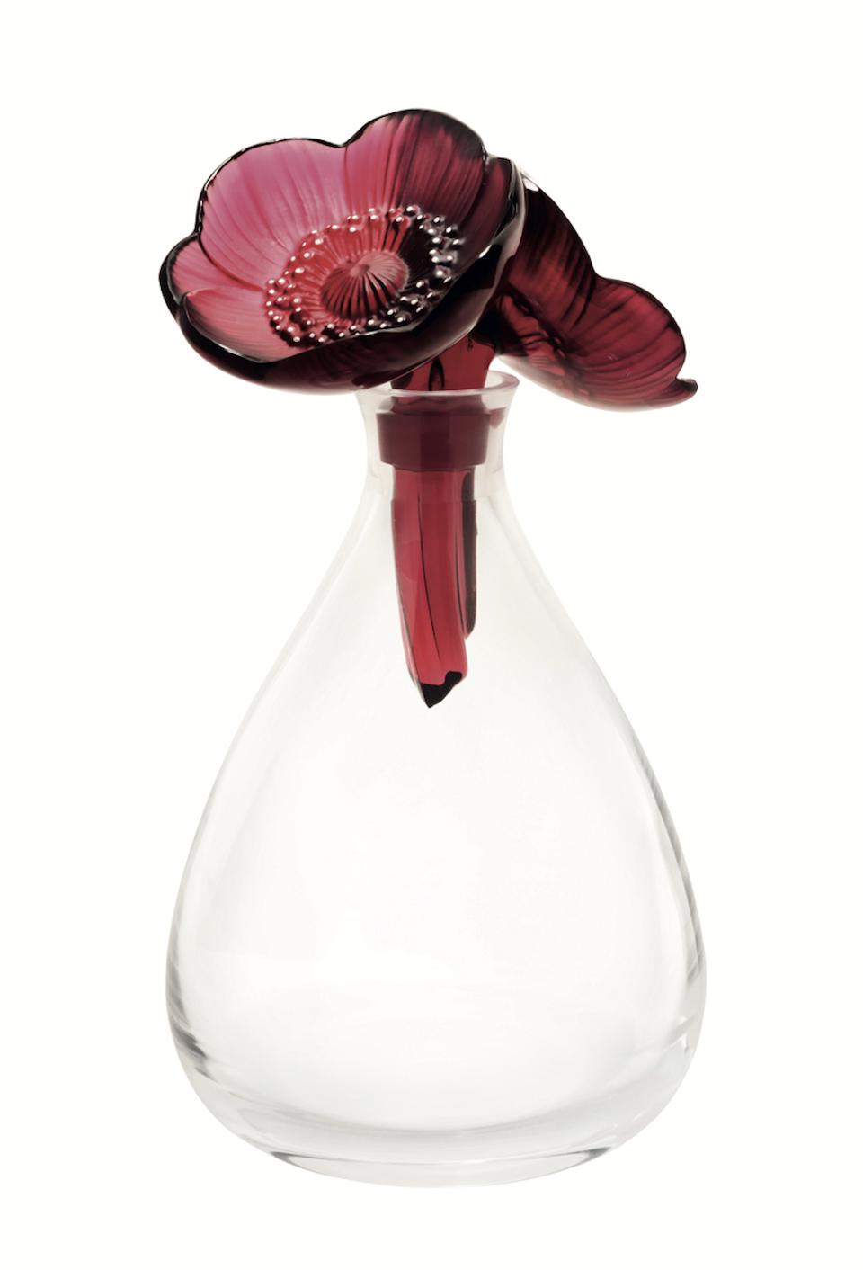 A Lalique crystal decanter with floral motifs.