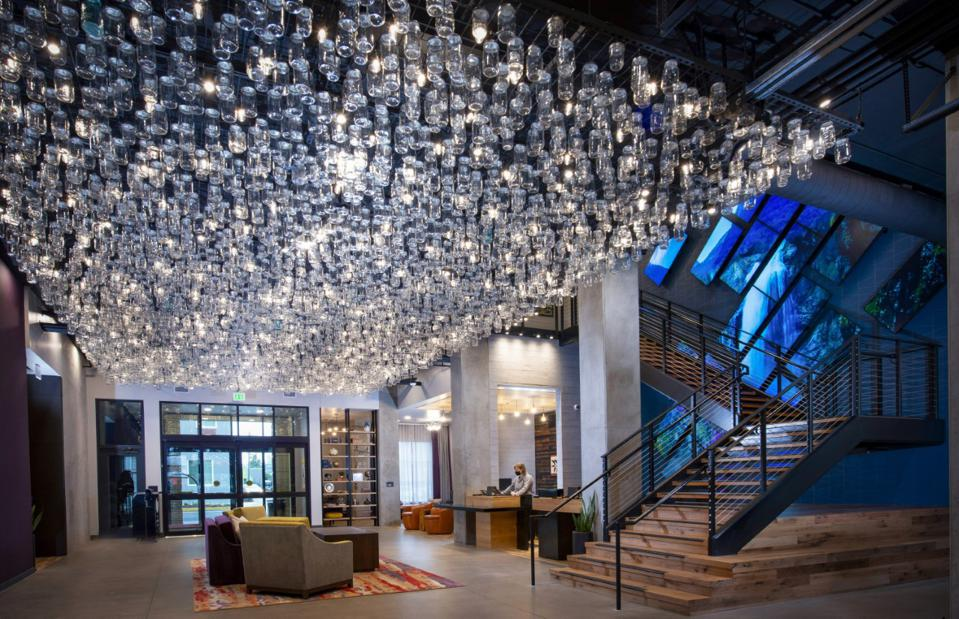 glass bottles hanging from ceiling i hotel lobby