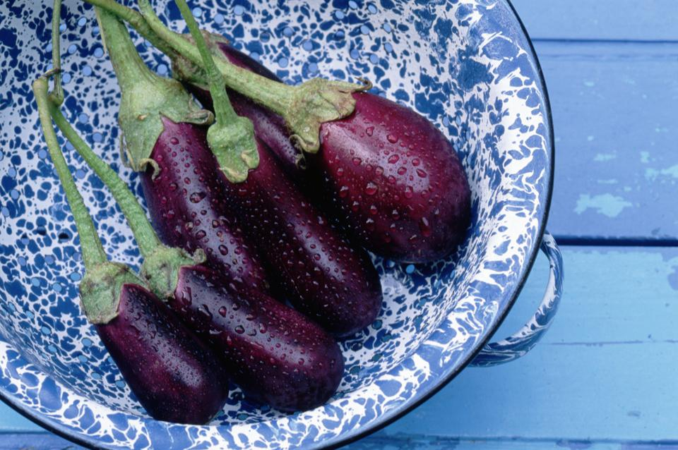 Wet Eggplants in a Blue Bowl
