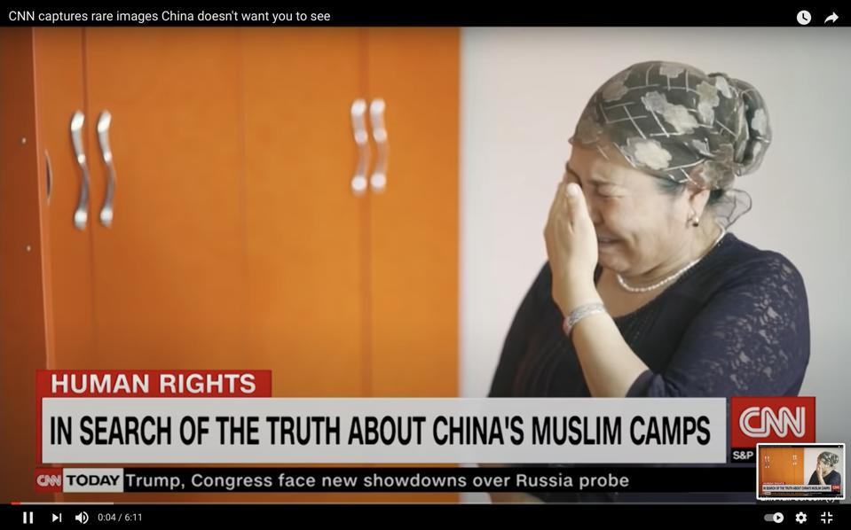 Crying Uyghur mother