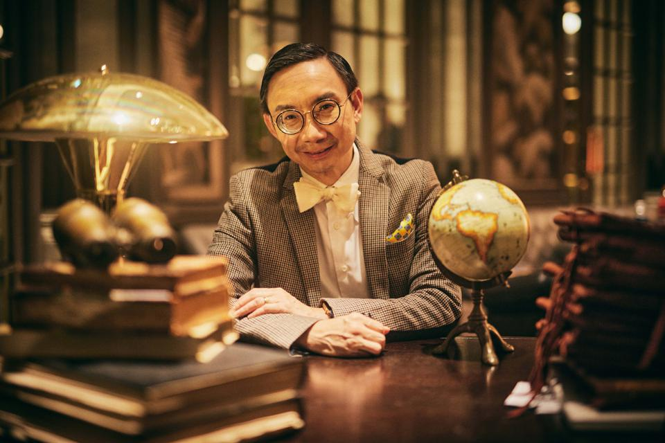 Actor/director Hossan Leong sits in the study at the Raffles Singapore.