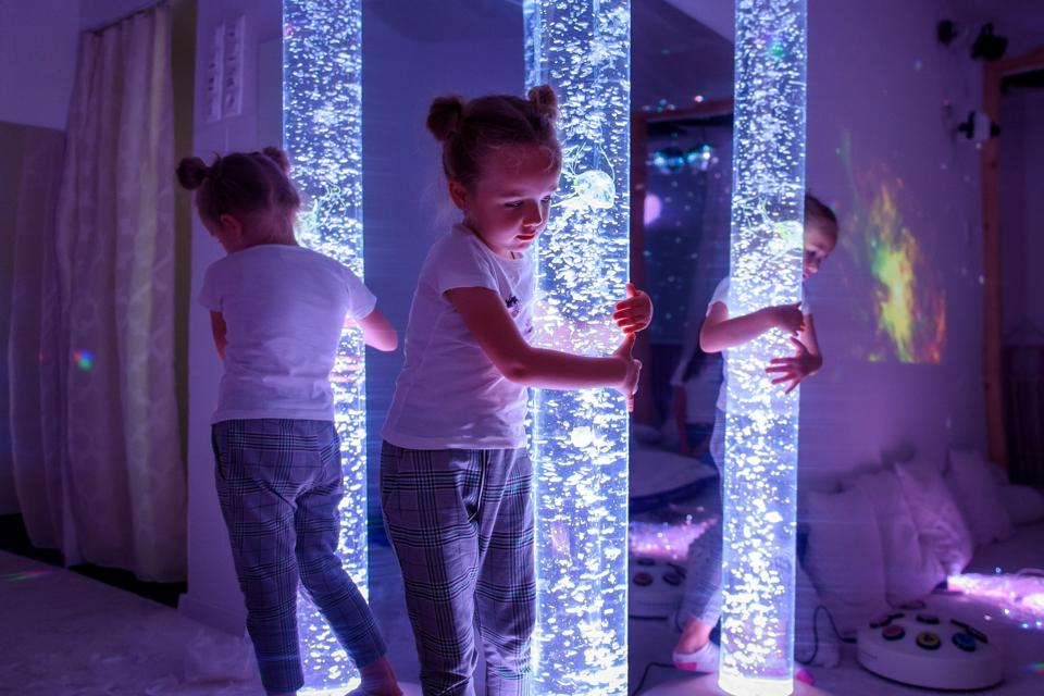 Child in therapy sensory stimulating room, snoezelen.