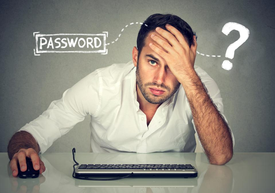 Desperate person trying to log into a computer but can't remember password