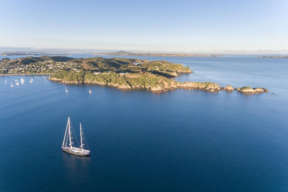 Twizzle sails past islands