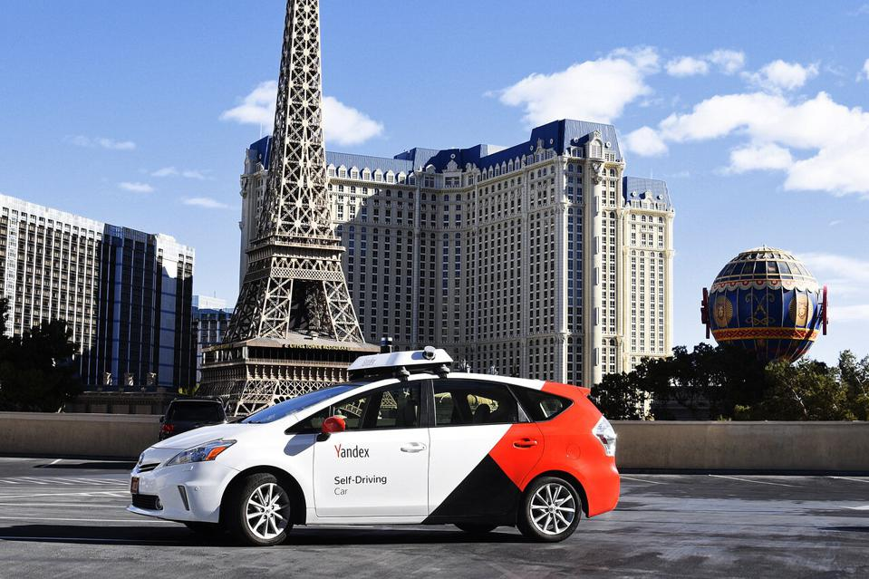 A Yandex self-driving car parked in front of the Paris Las Vegas Hotel & Casino.