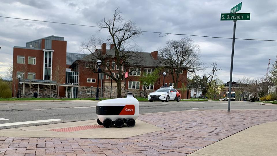 A Yandex Rover delivery robot on a sidewalk in Ann Arbor, Michigan.