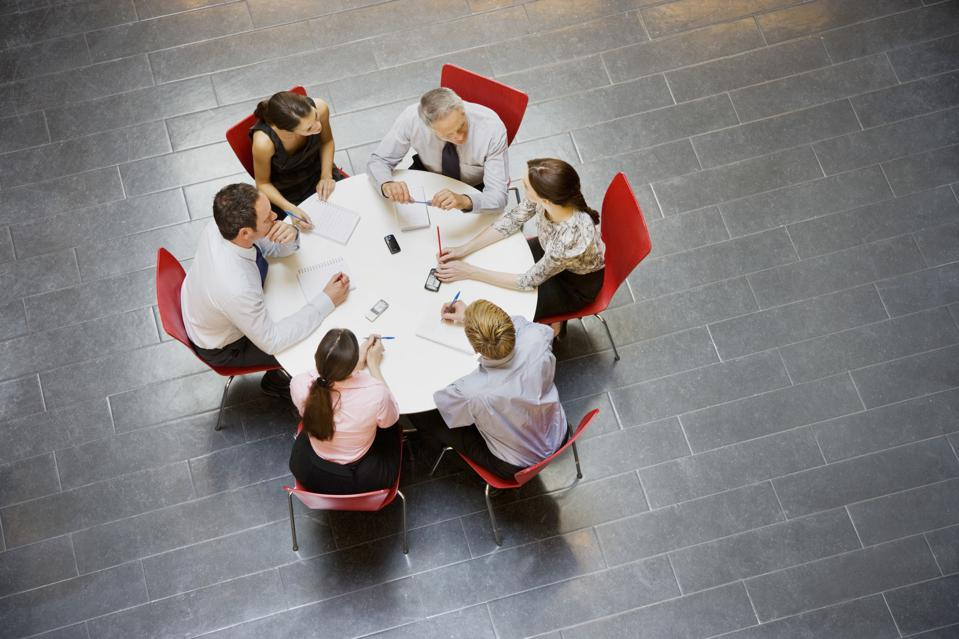 Business people having a meeting at round table