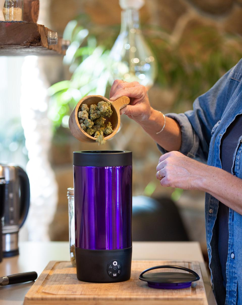 Cannabis being poured into the Ardent FX infusing and baking device.