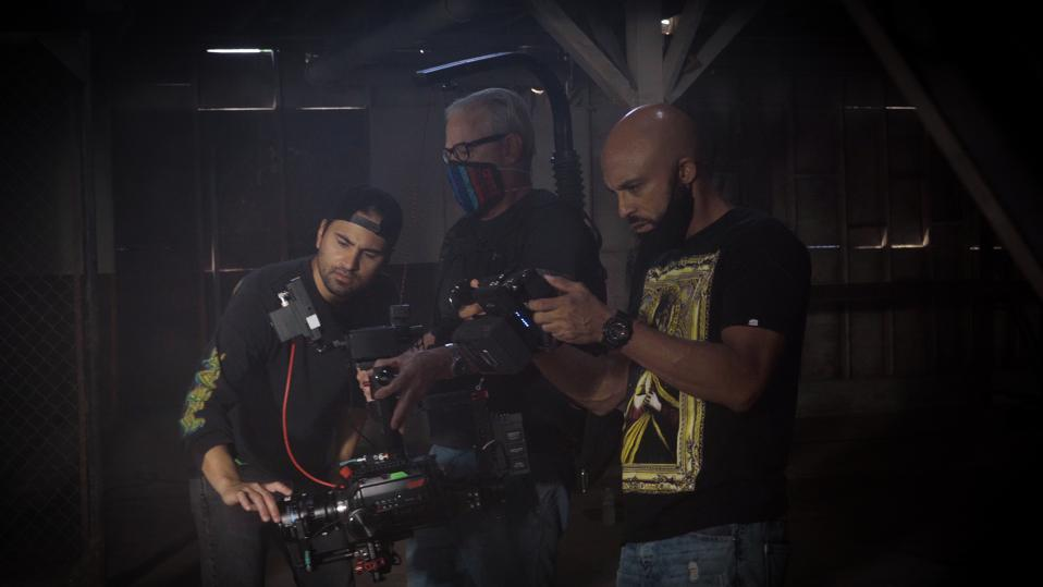 David Bianchi watching back video on set of his Spinema Film ″Wade in The Water″