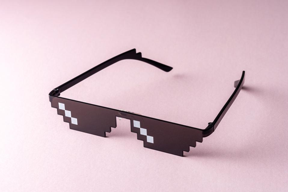 Meme Pixel glasses on pink background. Minimal concept.