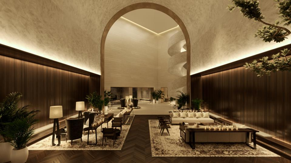 The amber-lit, wood-paneled lobby of the Dubai EDITION, opening later this year.