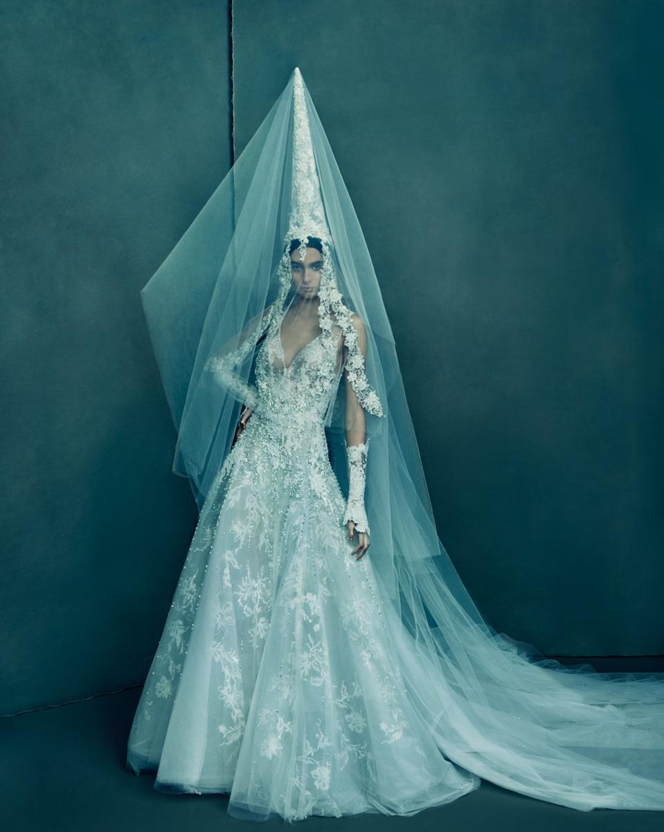 Reem Acra's dress influenced by Lebanese culture. The designer created all of the headpieces.