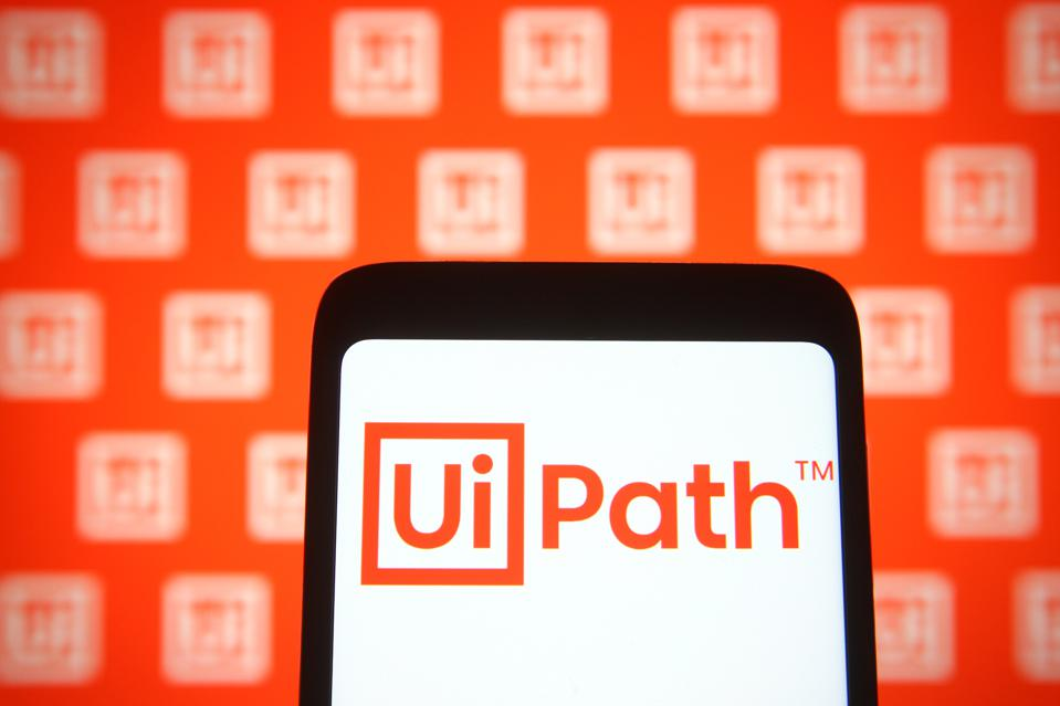 In this photo illustration, UiPath logo of a software...