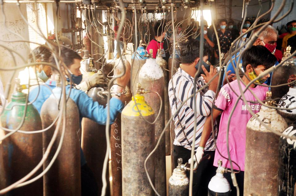 People Stand In Queue To Get Their Oxygen Cylinders Replenished
