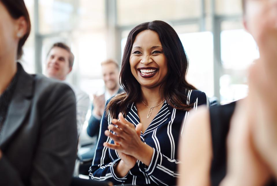 Business woman happy to hear that she received a promotion